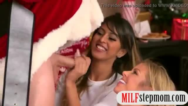 MILF and teen fucking with horny Santa